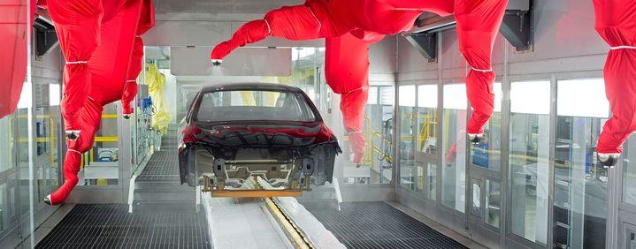 Robots paint a car body